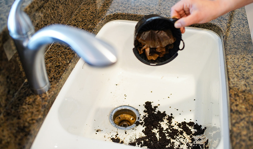 can you put coffee grounds down the sink?